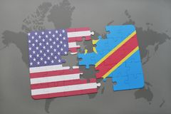 Puzzle with the national flag of united states of america and democratic republic of the congo on a world map background. Puzzle with the national flag of Stock Photography