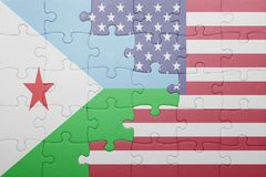 Puzzle with the national flag of united states of america and djibouti Stock Photo