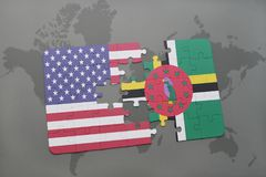 Puzzle with the national flag of united states of america and dominica on a world map background. Concept stock photo