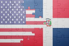 Puzzle with the national flag of united states of america and dominican republic. Concept Royalty Free Stock Photos