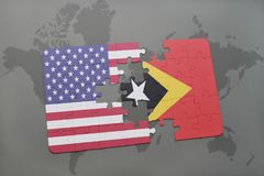 puzzle with the national flag of united states of america and east timor on a world map background Royalty Free Stock Image