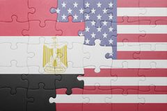 Puzzle with the national flag of united states of america and egypt. Concept Stock Photos
