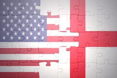 Puzzle with the national flag of united states of america and england Royalty Free Stock Photography