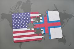 Puzzle with the national flag of united states of america and faroe islands on a world map background. Concept Royalty Free Stock Photos