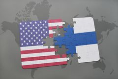 Puzzle with the national flag of united states of america and finland on a world map background. Concept Stock Photos