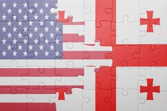Puzzle with the national flag of united states of america and georgia. Concept Stock Images