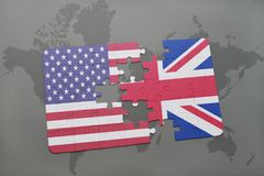 Puzzle with the national flag of united states of america and great britain on a world map background. Concept Stock Photography