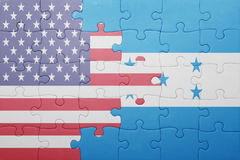 Puzzle with the national flag of united states of america and honduras. Concept Stock Photo