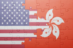 Puzzle with the national flag of united states of america and hong kong. Concept stock images