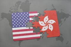 Puzzle with the national flag of united states of america and hong kong on a world map background. Concept Royalty Free Stock Photography