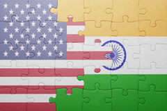 Puzzle with the national flag of united states of america and india. Concept Stock Image