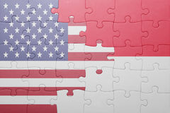 Puzzle with the national flag of united states of america and indonesia. Concept Royalty Free Stock Photography