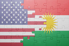 Puzzle with the national flag of united states of america and kurdistan Stock Image