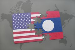 Puzzle with the national flag of united states of america and laos on a world map background. Concept Stock Photography