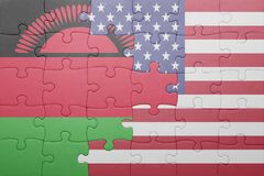 Puzzle with the national flag of united states of america and malawi. Concept Royalty Free Stock Photo
