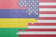 Puzzle with the national flag of united states of america and mauritius. Concept Stock Photo