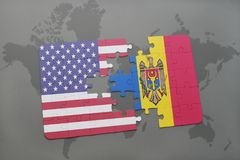 Puzzle with the national flag of united states of america and moldovaon a world map background. Puzzle with the national flag of united states of america and Stock Image