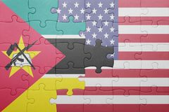 Puzzle with the national flag of united states of america and  mozambique Stock Photo