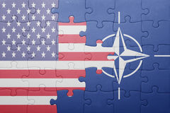 Puzzle with the national flag of united states of america and nato Royalty Free Stock Image