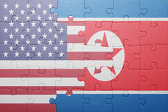 Puzzle with the national flag of united states of america and north korea. Concept stock photography