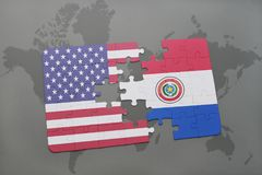 Puzzle with the national flag of united states of america and paraguay on a world map background. Concept Royalty Free Stock Photo