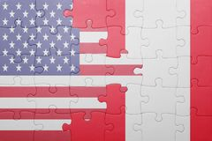 Puzzle with the national flag of united states of america and peru. Concept Stock Photo