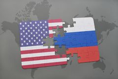 Puzzle with the national flag of united states of america and russia on a world map background. Concept stock images