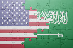 Puzzle with the national flag of united states of america and saudi arabia Royalty Free Stock Photos