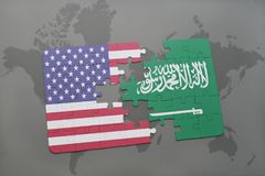 Puzzle with the national flag of united states of america and saudi arabia on a world map background Royalty Free Stock Images