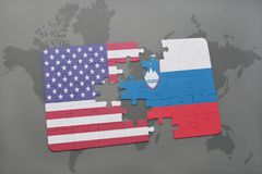 Puzzle with the national flag of united states of america and slovenia on a world map background Stock Photo