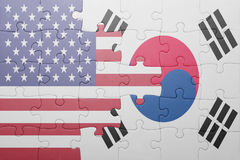 Puzzle with the national flag of united states of america and south korea. Concept stock photo