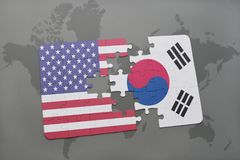 puzzle with the national flag of united states of america and south korea on a world map background Stock Photos