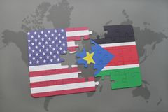 Puzzle with the national flag of united states of america and south sudan on a world map background. 3D illustration Royalty Free Stock Photography