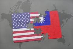 Puzzle with the national flag of united states of america and taiwan on a world map background. Concept royalty free stock photography