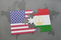 Puzzle with the national flag of united states of america and tajikistanon a world map background. Puzzle with the national flag of united states of america and Royalty Free Stock Image