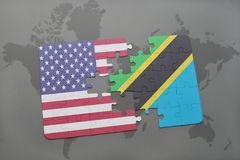 Puzzle with the national flag of united states of america and tanzania on a world map background. 3D illustration Royalty Free Stock Images
