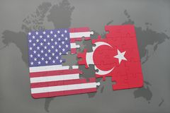 Puzzle with the national flag of united states of america and turkey on a world map background Royalty Free Stock Photography