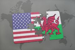puzzle with the national flag of united states of america and wales on a world map background Stock Photo
