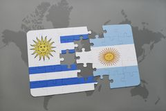 Puzzle with the national flag of uruguay and argentina on a world map background. Royalty Free Stock Photos