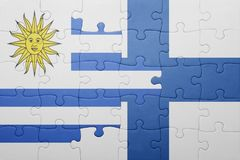 Puzzle with the national flag of uruguay and finland Stock Image