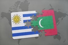 Puzzle with the national flag of uruguay and maldives on a world map. Background. 3D illustration Royalty Free Stock Photo