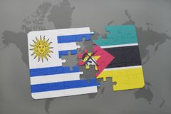 Puzzle with the national flag of uruguay and mozambique on a world map. Background. 3D illustration Royalty Free Stock Photography