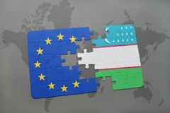 Puzzle with the national flag of uzbekistan and european union on a world map Royalty Free Stock Images