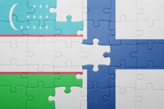 Puzzle with the national flag of uzbekistan and finland Stock Photo