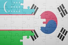 Puzzle with the national flag of uzbekistan and south korea. Concept stock image