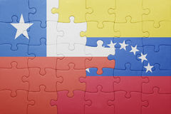 Puzzle with the national flag of venezuela and chile. Concept stock photography