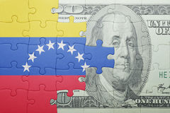Puzzle with the national flag of venezuela and dollar banknote Stock Photos