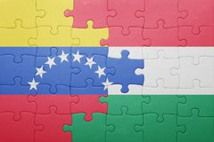 Puzzle with the national flag of venezuela and hungary Royalty Free Stock Image