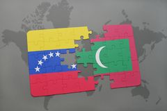 Puzzle with the national flag of venezuela and maldives on a world map. Background. 3D illustration Royalty Free Stock Photos