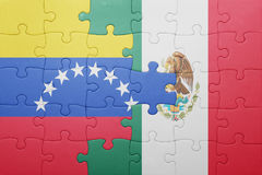Puzzle with the national flag of venezuela and mexico. Concept Stock Photos